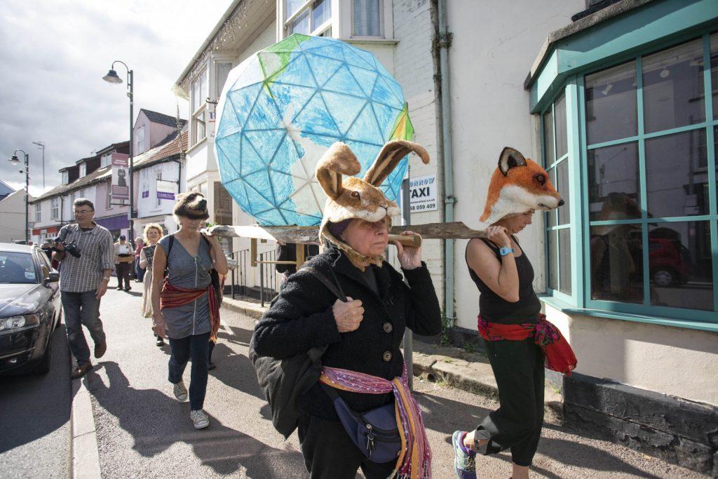 Globe carried along Monnow Street
